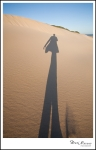 A little fun... I love the shadow of the sand kicked up as I walk.